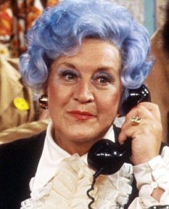 "An exaggerated example of  a blue-haired senior, via ""Are You Being Served?"""